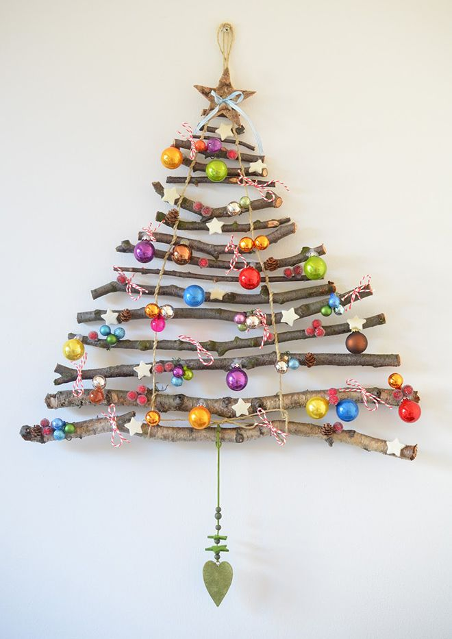 Get back to nature and collect a handful of branches for a rustic Christmas wall hanging