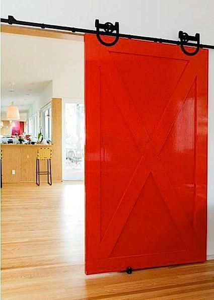 Glossy candy red interior barn door. All things I like (including candy). via David D. Harlan Architects [design by Barbara Bestor http://www.bestorarchitecture.com/interiors/interiors.html]