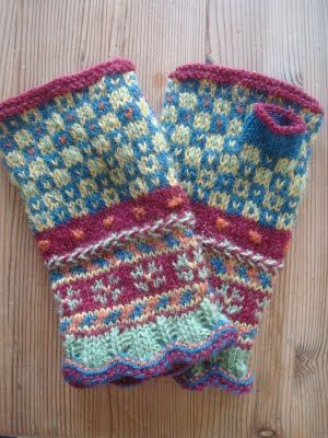 Latvian fingerless mitts. I don't knit much fair isle, but these are beautiful; love the color combination