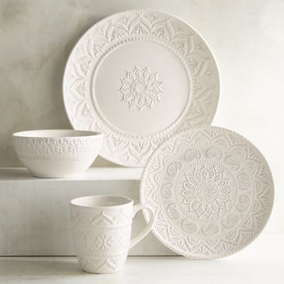 Our Chateau Clair Dinnerware is an impressive display on any table. Making an interesting and fresh presentation, the hand-painted, whitewashed stoneware with raised, lace-like detail is suitable for everyday use and more formal occasions.