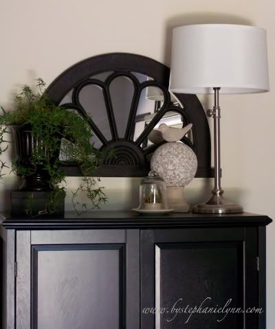 Great for the top of armoire. Lamp, mirror, greenery, and a few smaller accessories.