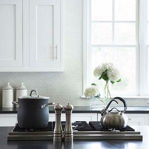 linda mcdougald design kitchens white shaker kitchen cabinets light gray small tiles backsplash farmhouse sink honed black granite - Schwarzweimosaikfliese Backsplash
