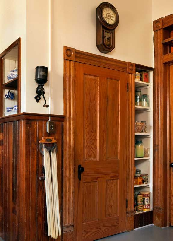 Late-Victorian Kitchen - Behind the pantry door hide the modern refrigerator and a microwave oven.