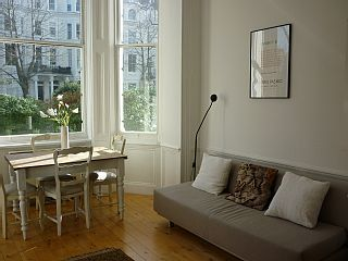 $1777 1 brm Lovely Bright Flat In Superb Notting Hill location. 12 min to tube. ?? Couch but not sure how comfy.