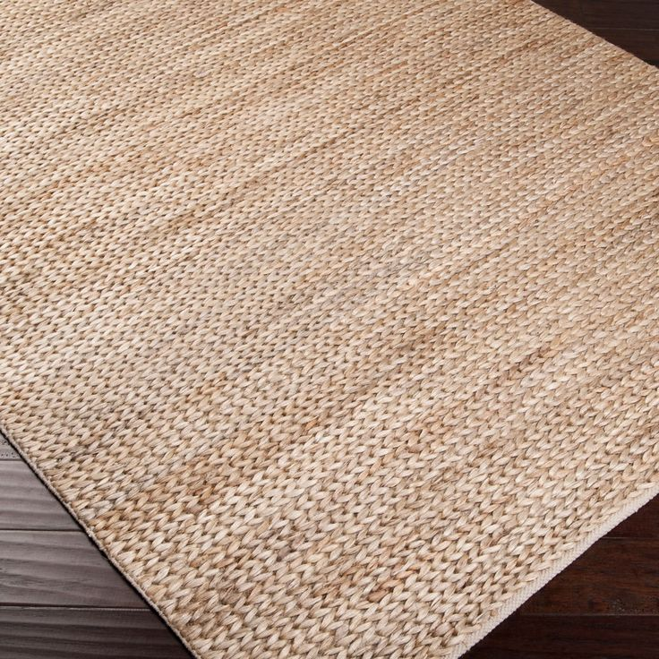 "Born of high quality, innovation and luxury, Surya reinterprets top trends into beautiful and lasting pieces for the home. The Tropic rug exudes rich warmth with subtle sophistication and depth. In natural shades of beige and tan, this chic floor covering delivers the modern living room classic and durable style. Hand woven from 100% jute.  Available in custom sizes. Please contact shop@laylagrayce.com for more information. 2' x 3'. 3'6"" x 5'6"". 5' x 8'. 8' x 11'. Rug pad recommended."