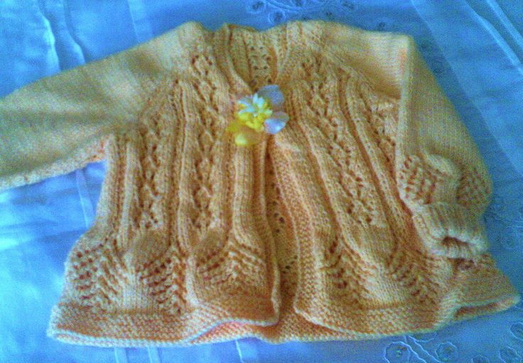 Buttercup yellow lacy jacket. Size 0 - 6 months.