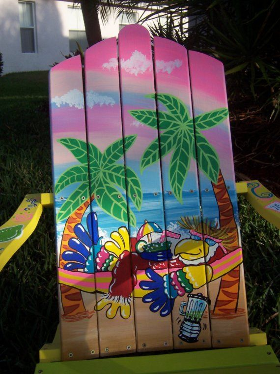 This Adirondack Chair is handcrafted and hand painted on pine wood. The measurements are approximately 36 high, 28 wide and 31.5 deep.  We have painted a really awesome parrot hanging out on his hammock. The parrot has his cocktail in his hand. We have added two palm trees. We have added a really pretty blue and pink sky. We have painted one arm with a colorful shark pulling a banner that says Margaritas. The other arm has a Margarita, salt shaker and some limes.  We paint all of our chairs…
