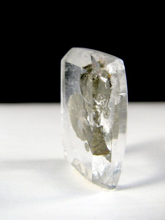One of the most unique quartz varieties is a gorgeous crystal quartz that has the mineral pyrite encapsulated within its confines. Small pyrite