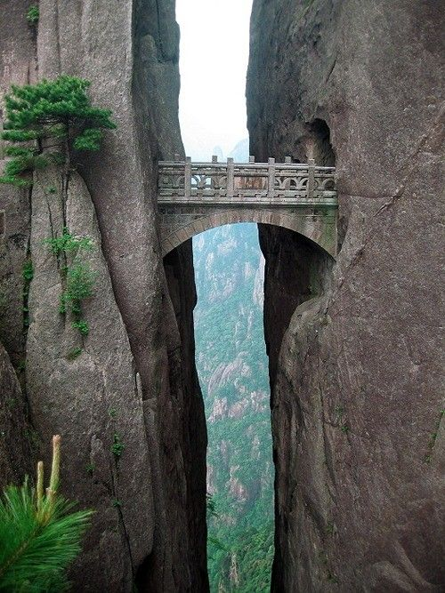 The Bridge of Immortals, Huangshan, China ~ Strangely-shaped granite peaks, amazing scenery, beautiful sunsets and striking heights. The Yellow Mountains in eastern Asia is really something every person should experience. The world's highest bridge, The Bridge Of Immortals, is situated in the Yellow Mountains, also known as Huangshan. From the bridge you will have a breathtaking view, and see how the clouds are touching mountainsides beneath you.
