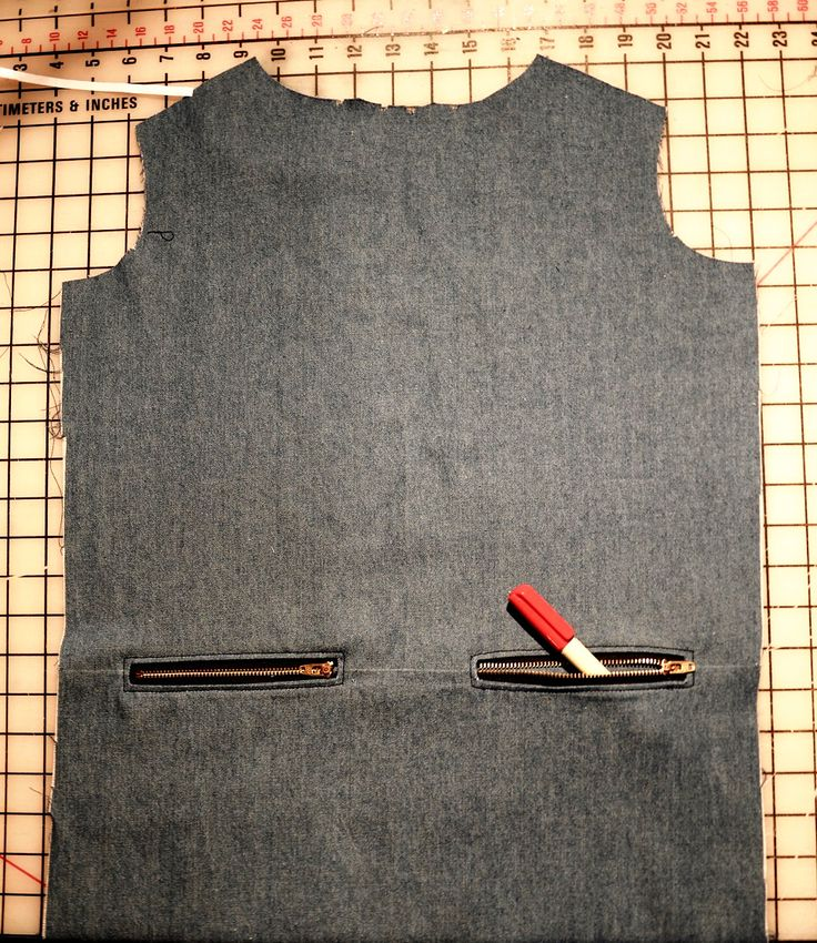 exposed zippers on welt pockets