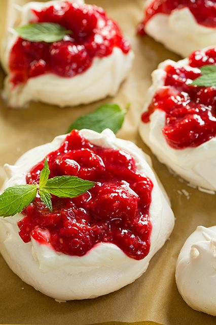 Individual Pavlovas with Cream Cheese Whipped Cream and Raspberry Sauce - these are completely divine! Their natural colors make them perfect for the holidays.