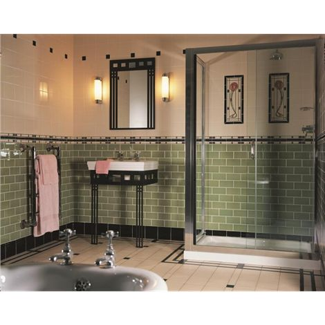 This Art Deco style bathroom uses striking green metro style Palm Green half tiles, with the stylised Glasgow Rose tile set to create detail and add interest.