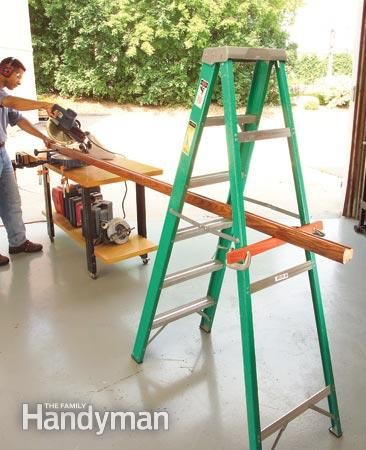 OK, we admit that a proper miter saw stand is better, but if you're just cutting a couple of long pieces, here's a quick way to support them. Just clamp a piece of scrap on the back legs of a stepladder. You'll have to snake boards through the ladder to support them, but the ladder is rock-solid and you can adjust the support piece so it's perfectly level with your saw table