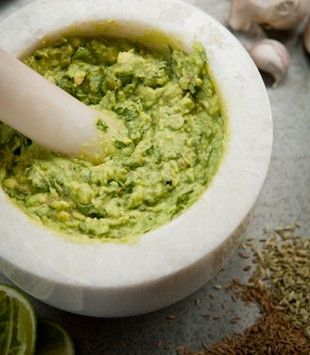 Guacamole with lime, cumin & fennel seeds: - 4 ripe avocados - 1 small clove garlic - 1 heaped tsp flaked salt - 1 tsp fennel seeds - 1 tsp cumin seeds - black pepper - 2 limes, juiced - 1/4 bunch coriander, leaves only, roughly chopped - 1 green chilli, finely sliced