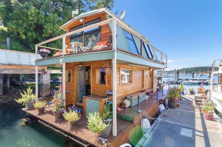 This Gorgeous Tiny House Floats on Water, and We're Totally On Board - See Inside This Rustic Floating House