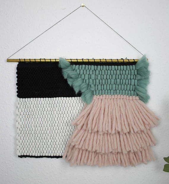 Cute woven wallhanging with super fluffy fringes and an allover soft look and feel. This wall decor is handmade by me on a loom and adds some extra coziness in every living room, bedroom and nursery. Be prepared to get addicted by its fluffiness! height: 29 cm lenght: 40 cm