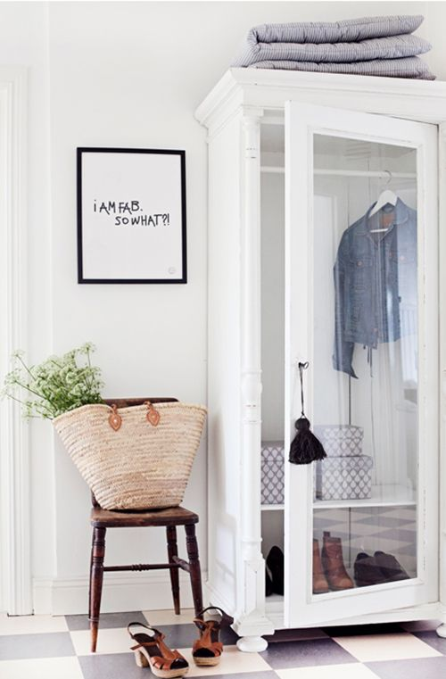 clean white entry, love the glass armoire!