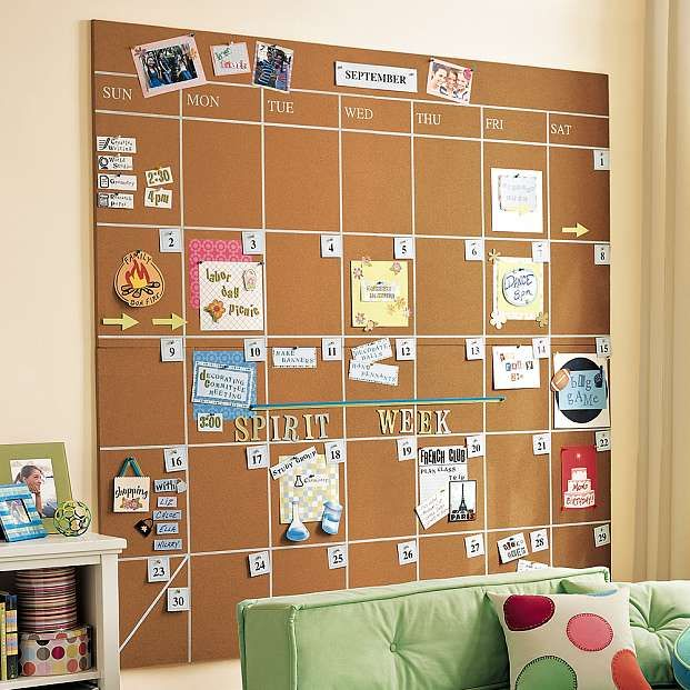 Corkboard calendar - I like that you can pin tickets and invites right on the board. THIS IS PERFECT