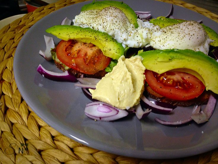 Whole wheat toast served with avocado and poached eggs