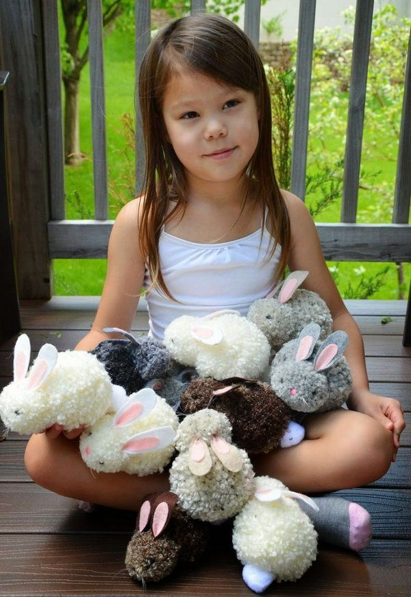 Easy to Make Pom-pom Bunnies for Kids. How cute the bunnies are! They are much easier to make than you can imagine even with the kids hands. Tutorial via