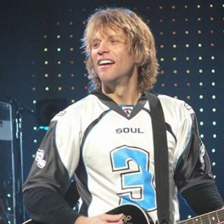 Jon Bon Jovi wearing a Philadelphia Soul football jersey. @bonjovi_mania Instagram