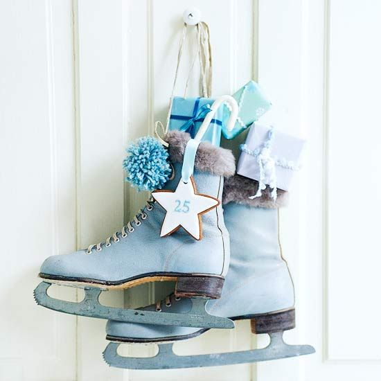 Use unused skates in your holiday decor to add vintage inspiration to your Christmas decorations. More holiday decorating ideas: http://www.bhg.com/christmas/outdoor-decorations/front-door-christmas-decorating-ideas/?socsrc=bhgpin112812hangskates