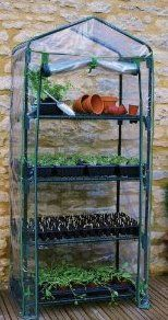 4 tier mini greenhouse is great for beginners when starting a Potted Vegetable Garden.  In here you can raise seedlings.  Bring sick plants back to health and grow plants throughout the winter.  I use mine to start plants extra early in spring too.  Click on the photo to find out more at www.pottedvegetablegarden.com