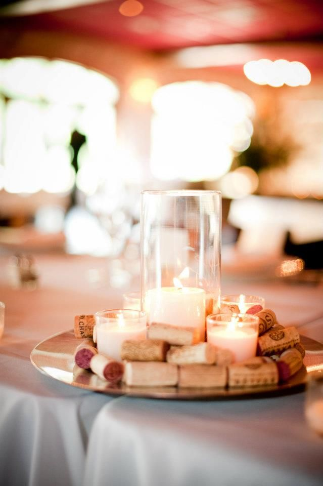 Easy (and affordable!) wine cork decor for a wedding. instead of the clear vase, use the top of a wine bottle