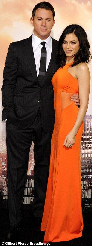 Best supporting wife: The actor cuddled up to his gorgeous wife Jenna Dewan on the red car...