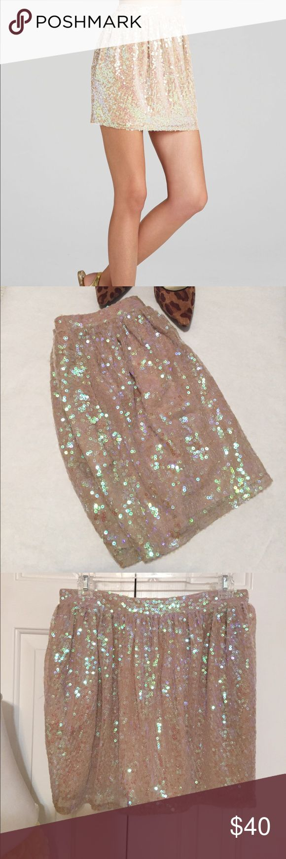BCBGeneration Sequin Dirndl Skirt Shine bright in this scene stealing sequins with party perfect BCBGeneration skirt. Banded waist with ruching. Back center zipper. Side pockets! Fully lined. Color Nude. 100% Polyester shell and lining. Brand new with tags. Open to close offers! BCBGeneration Skirts Mini