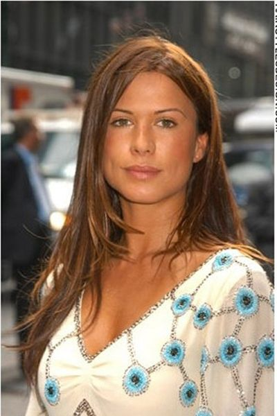Rhona Mitra looks chic and classy with this very long hairstyle. Her hair is completely straight and this looks adorable. Her hair falls nicely down past the shoulders and on one side she has her hair styled behind her ear.Her hair is cut long and it is layered.Rhona's hair colour is a beautiful warm chocolate brown.