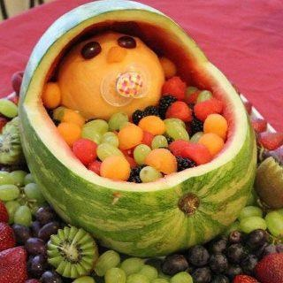 Baby in a bassinet for a fruit bowl babyshower funideas fruitsalad