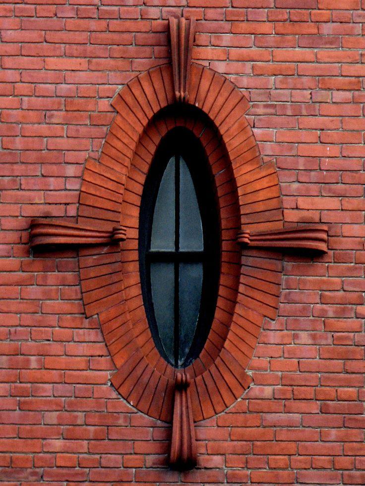 Burlington, Vermont. tile wall, building, oval shaped window