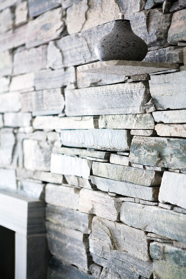 Matching stone shelf on stone wall