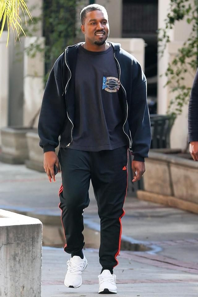 568bc791f Kanye West walking in California in his sporty Adidas soccer pants ...