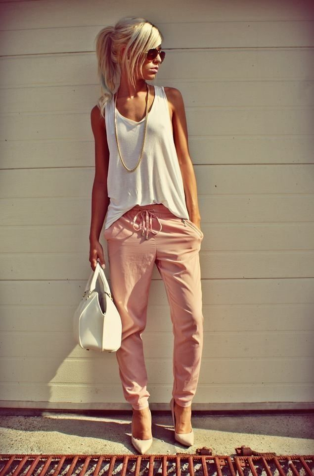 Sleeveless white tunic paired with slightly haremed jogging pants + bag (matches top) and pointy low heels