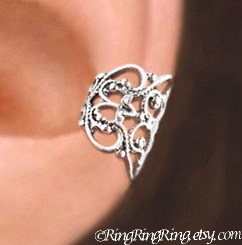 100% Solid Sterling Silver. This beautifully detailed silver ear cuff wraps around your cartilage in a stylish way. You can wear it on the right or