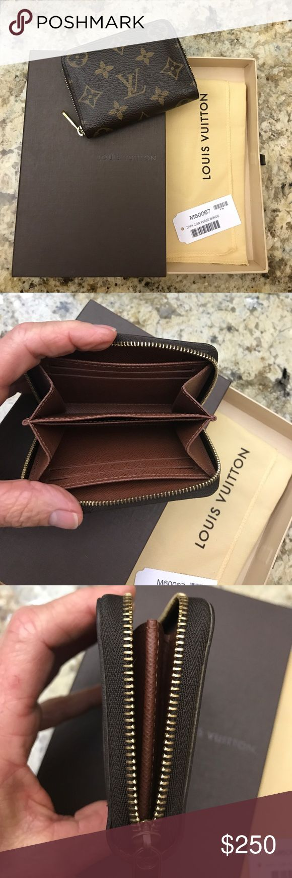 Louis Vuitton coin purse Louis Vuitton coin purse, 4 slots for credit cards. Great for anyone's lifestyle. Louis Vuitton Bags Wallets