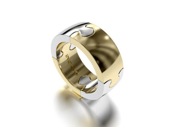 Puzzle II ring 4 pieces in a row by SaarikorpiDesign on Etsy, €1550.00