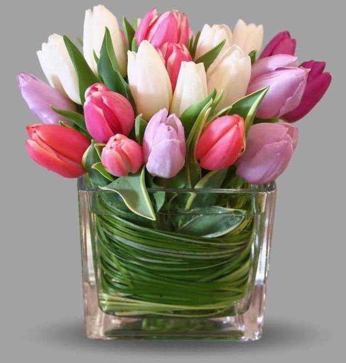 Pink White Purple Tulips Small Square Vase Grey Background Floral Centerpieces In 2020 Tulips Arrangement Easter Flower Arrangements Beautiful Flower Arrangements