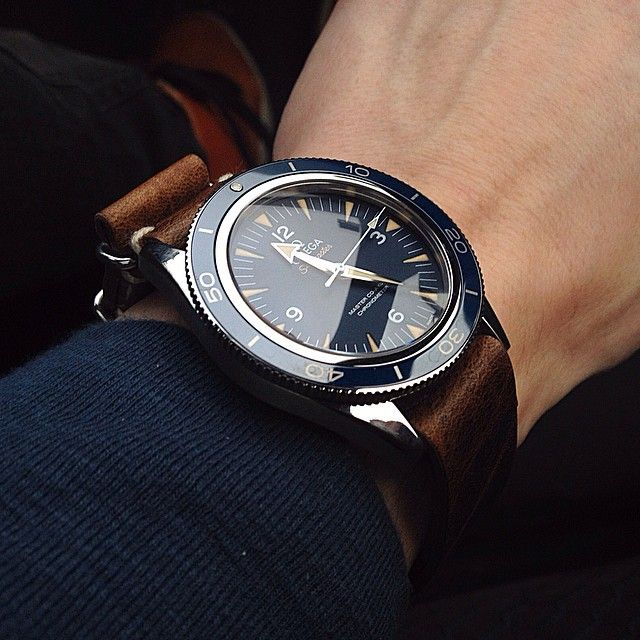 The re-envisioned Omega Seamaster 300 Master Co-Axial, modeled closely upon the famous Seamaster of the 60s, caused quite a stir in the horological community a few years ago. It is a bit thick for my liking, but boy, is it a handsome sight with a leather nato strap.