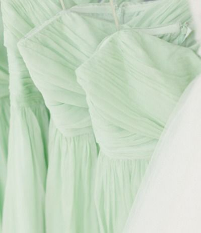 Mint green bridesmaid dresses. I was thinking of having half of the Bridesmaids the pink color and half this light green color.