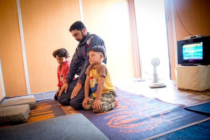 Day 1: Ziad, 31, is a father of three, with another child on the way. On the first day of Ramadan, Ziad returns to his family's caravan after working a shift as a guard in Za'atri refugee camp. 'Last Ramadan, I was in prison [in Syria],' he recalls. His wife and children would tell him to come home, but each time he would have to tell them, 'I can't, the door is locked.' He becomes emotional as he remembers those days, when he was unable to buy gifts for his children. Last year in prison