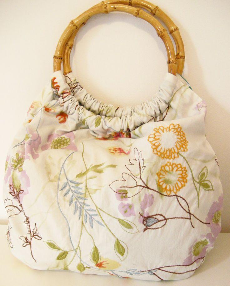 DIY purse, DIY handbag, handmade handbag, handmade purse, embroidered fabric, round purse handles, bamboo purse handles, easy sewing project