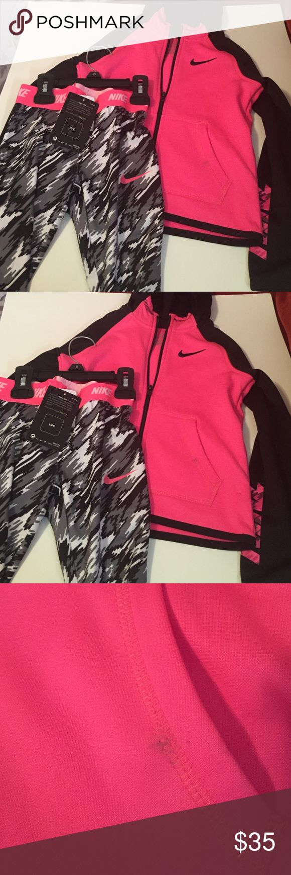 Girls Nike jogging suit Girls 2 piece Nike jogging suit new with tags size 6 was for granddaughter but too small there is a small spot on suit by pocket other wise brand new pink gray white Nike Matching Sets