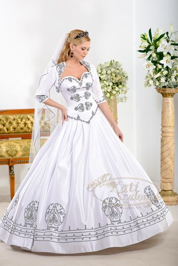 "A very special hungarian style wedding dress, with black and white ""sújtás"", and a bolero that comes with."