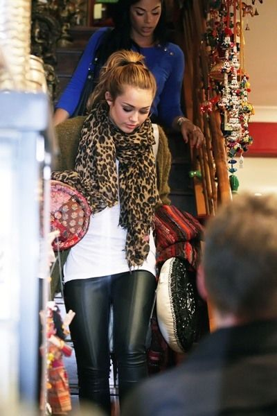 leopard scarf and leather leggings Christmas shopping outfit