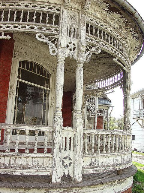 The new owner has a family member working on the house and just in time as well. Ornate balustrade and posts show severe deterioration but are not too far gone to save. Some elbow grease, auto-body filler or epoxy filler, follwed by painting and everything can be returned to former glory. Good luck in saving and restoring this landmark home!