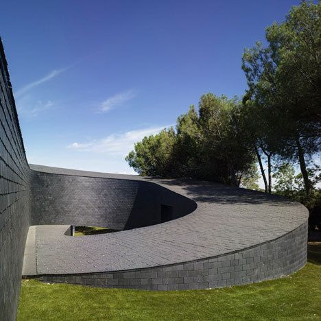 This House By Spanish Architects Subarquitectura Spirals Down A Sloping Site In Madrid