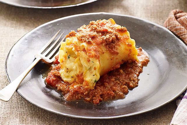 Creamy cheese, pasta sauce and ground beef get wrapped up in noodles and baked in this fun take on traditional lasagna.